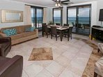 Tiled living/dining area with views of the Gulf from the 8th floor