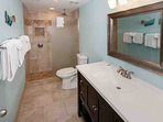 Master bath with single vanity, tile floors and walk-in shower