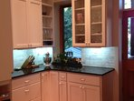 Granite counter tops and beautiful cabinetry.