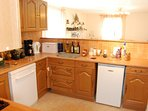 Fully equipped kitchen includes a dishwasher