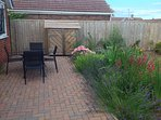 Outside dining with gas BBQ hut, large area for those sunny early morning breakfasts on the patio.