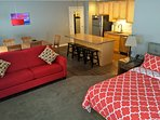 The main studio suite features a kitchen, bathroom, dining area, living area and sleeping area.