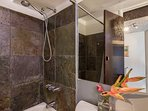 Stone Tiled Standing Shower