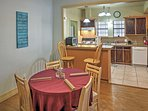 Enjoy formal meals at the 4-person dining table.