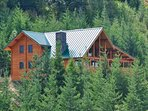 Summertime view of Alpine Lodge with year round access.