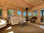 Gas stove and views from the Sun Room, a great place to enjoy conversation or a good book