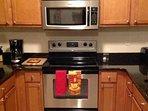 Modern Kitchen w/Stainless Steel Appliances & Granite Counter Tops