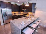 Modern Kitchen w/Stainless Appliances, Granite Counter Top & Breakfast Bar