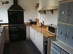 SMEG 5 burner, 3 ovens, belfast sink, American fridge/freezer lots of storage.