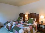 Twin beds in the master bedroom