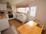 A fully fitted kitchen with all kitchen items you will need and a washing machine.