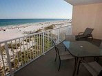 Al fresco dining and lounging overlooking beach and Gulf