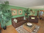 Enjoy a movie on the Flat Screen TV or Take in the Ocean View and Relax in this Spacious Living room with Sleeper Sofa