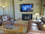 Family Room Downstairs, with New, Large Flat-Screen TV, and Leather Furniture.