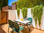 Orchard apartment. Outdoor dining on secluded terraces, surrounded by olive and citrus gardens.