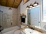 Remodeled master bathroom with tub and shower, granite and all new cabinetry