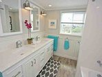 Family bathroom on 2nd level with tub, shower and double vanities