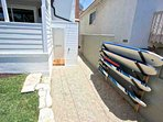 Outdoor shower and surfboard rack - great for a day at the beach!