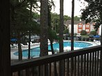 Our large deck overlooks the pool.