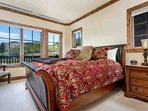 Master bedroom with king bed, views of Beaver Creek and Chair 15 featuring an en suite bath.