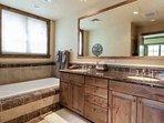 Beautiful master en suite bathroom with double vanity and deep tub.