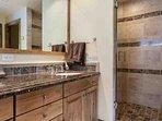 Master en suite bathroom features a separate large walk in shower.