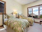 Bedroom 2 features 2 twin beds that can be bridged together as a king upon request.