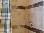 Shower/bath combo in bedroom 2 en suite bathroom.