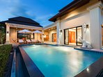 Spacious outdoor living area & private pool with warmness as home