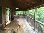 Deck with 2 hammocks, hammock chair, 2 wooden rockers, Grill and picnic table