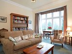 Elegant large bright comfortable sitting room overlooking park with sofa bed.