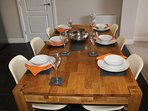 Huge oak table with modern Charles Eames style chairs - the ideal place to socialise
