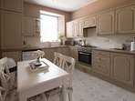 Fully equipped Kitchen with Dining table.