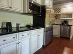 kitchen with convection microwave and cooktop