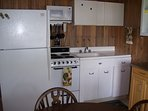 Kitchen with original porcelain cabinets refinished