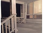 The large front porch that overlooks the countryside of the beautiful rolling hills and lake.