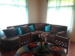 This is the open sitting area and dining table.