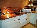 Kitchen with fridge/freezer, induction hob, dishwasher and microwave