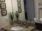 Granite countertop bathroom sink.