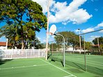 Tennis courts and half basketball court are located near pools and clubhouse