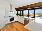 Large, modern kitchen with dishwasher - and the view!