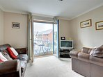 Living room leading out to balcony and views of Pembroke Castle