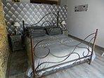 le lit en fer forgé 160