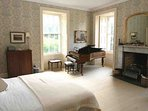 This classic first floor bedroom comes complete with its own grand piano!