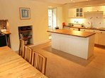 The modern bright kitchen has an oil fired range cooker as well as an electric hob and double oven