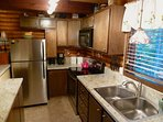 Boulder Creek Cottage offers a fully furnished updated kitchen.