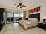 Beautiful comfy master bedroom with a great view.