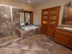 Master bath with double sinks, tile and granite