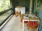 Screened-in lanai for fresh-air dining surrounded by nature.