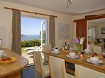 Cardigan Bay holiday house - french doors to patio with sea views